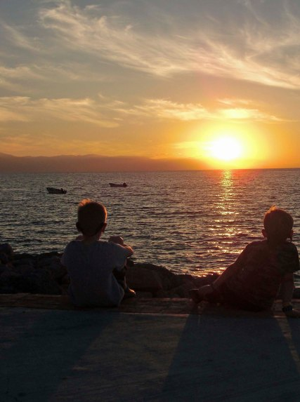 Our grandkids Ethan and Cody joined us in downtown Puerto Vallarta to catch the sunset. (Photo by Natasha Cox.)