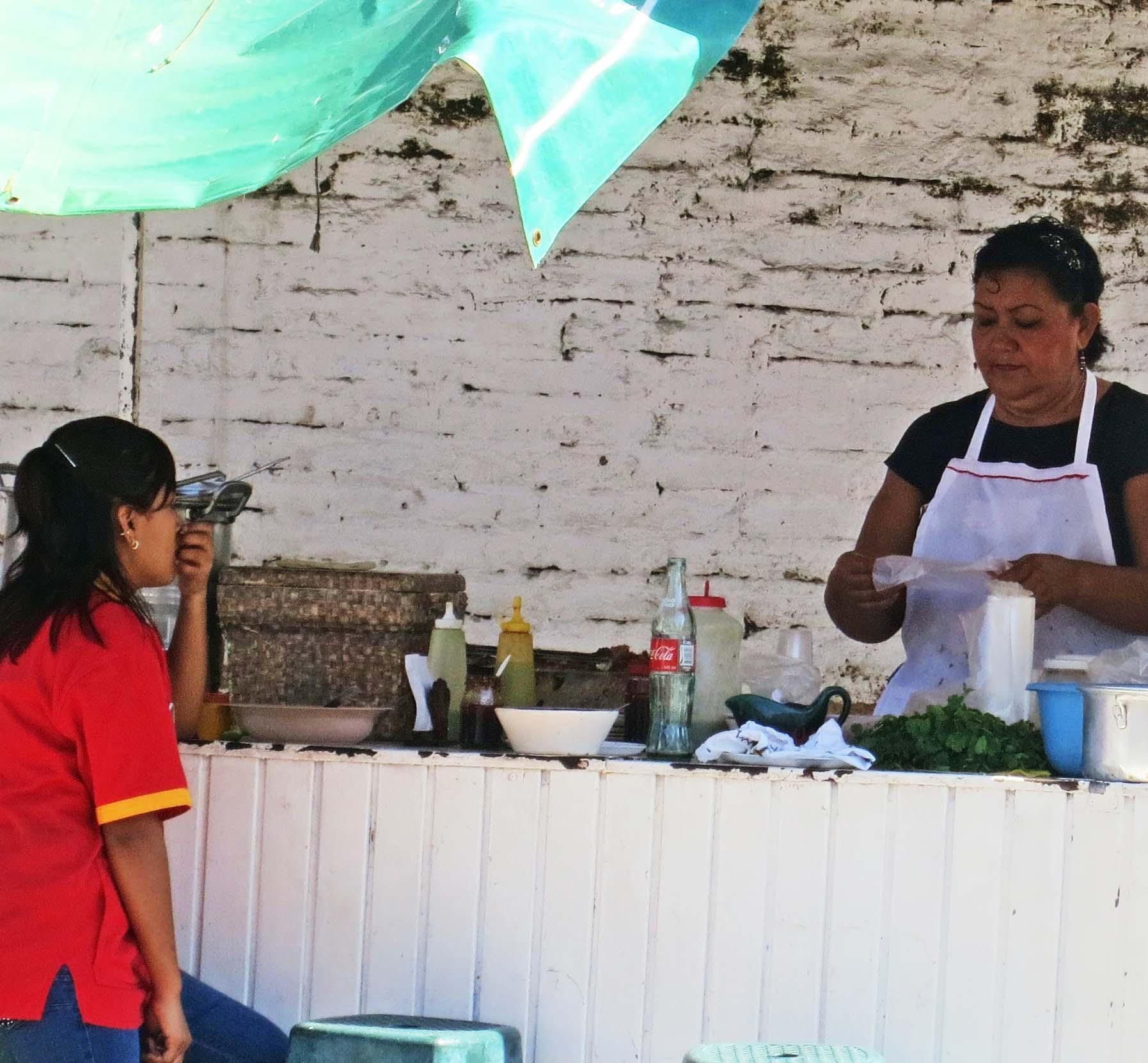 Street vendor selling food in Puerto Vallarta. Photo by Curtis Mekemson.