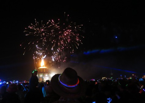 Fireworks provide a sendoff to the burning Man.