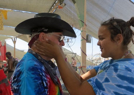 This woman had a unique way of gifting. She carried around an ice block and then put her icy hands on your face, which was perfect for a hot desert day. (Photo by Peggy Mekemson.)