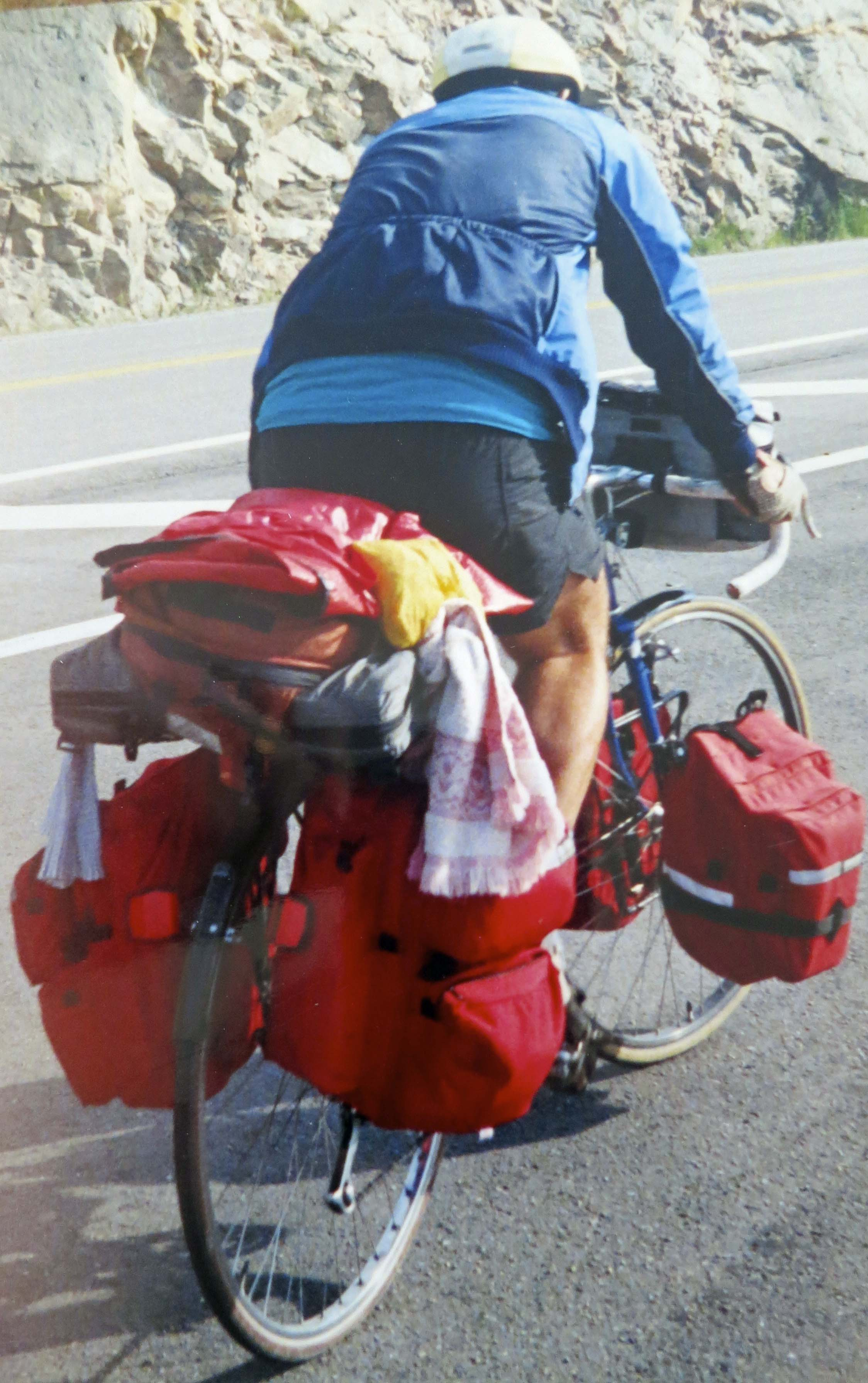 Ever wonder what it takes to bicycle 10,000 miles? One of my friends has suggested strong legs and a weak mind. I was half way through my trip bicycling up a very steep hill in Nova Scotia when this photo was taken.