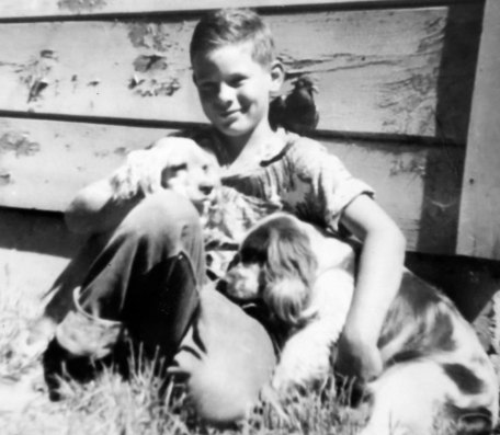Photo of Curt Mekemson as a child with pets.