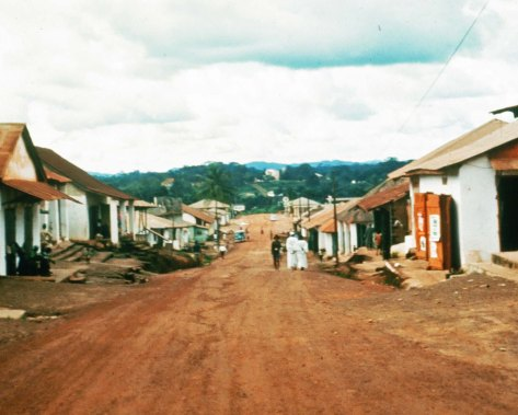 The main street of Gbarnga, Liberia where I served as a Volunteer in 1965-67. The large building you see in the distance was the Superintendent's compound. The high school and the house where I lived was off to the right.