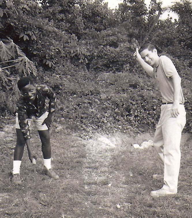 Gbarnga photo of Curt Mekemson and Sam Kollie.