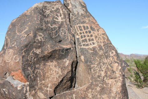 The grid on this rock is another example of archaic petroglyphs. There is some suggestion that the grid represents a rough map and the dots represent where people lived.