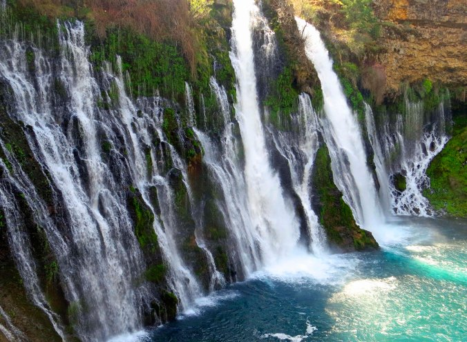Water comes out from layers of rocks as well as over the top at Burney Falls.