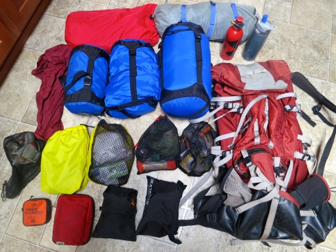 Here's my gear and backpack. The larger bags are tent, sleeping bag and pad, food, and clothes. Smaller bags are organized according to function: kitchen, bathroom, first aid, etc.