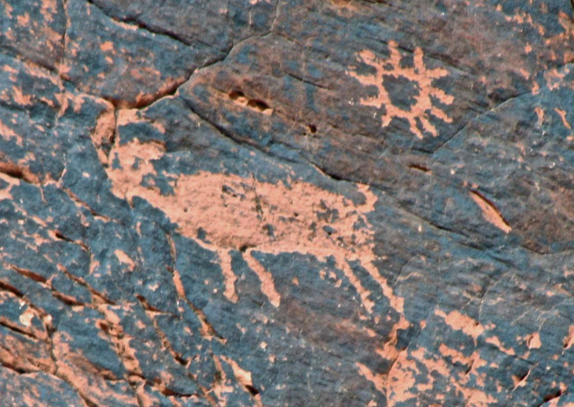 Big horn sheep petroglyph with sun at Valley of Fire State Park.