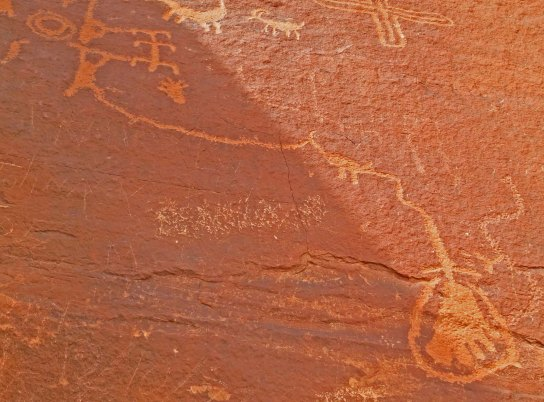 Petroglyph showing use of an atlatl at Valley of Fire State Park near Las Vegas, Nevada.