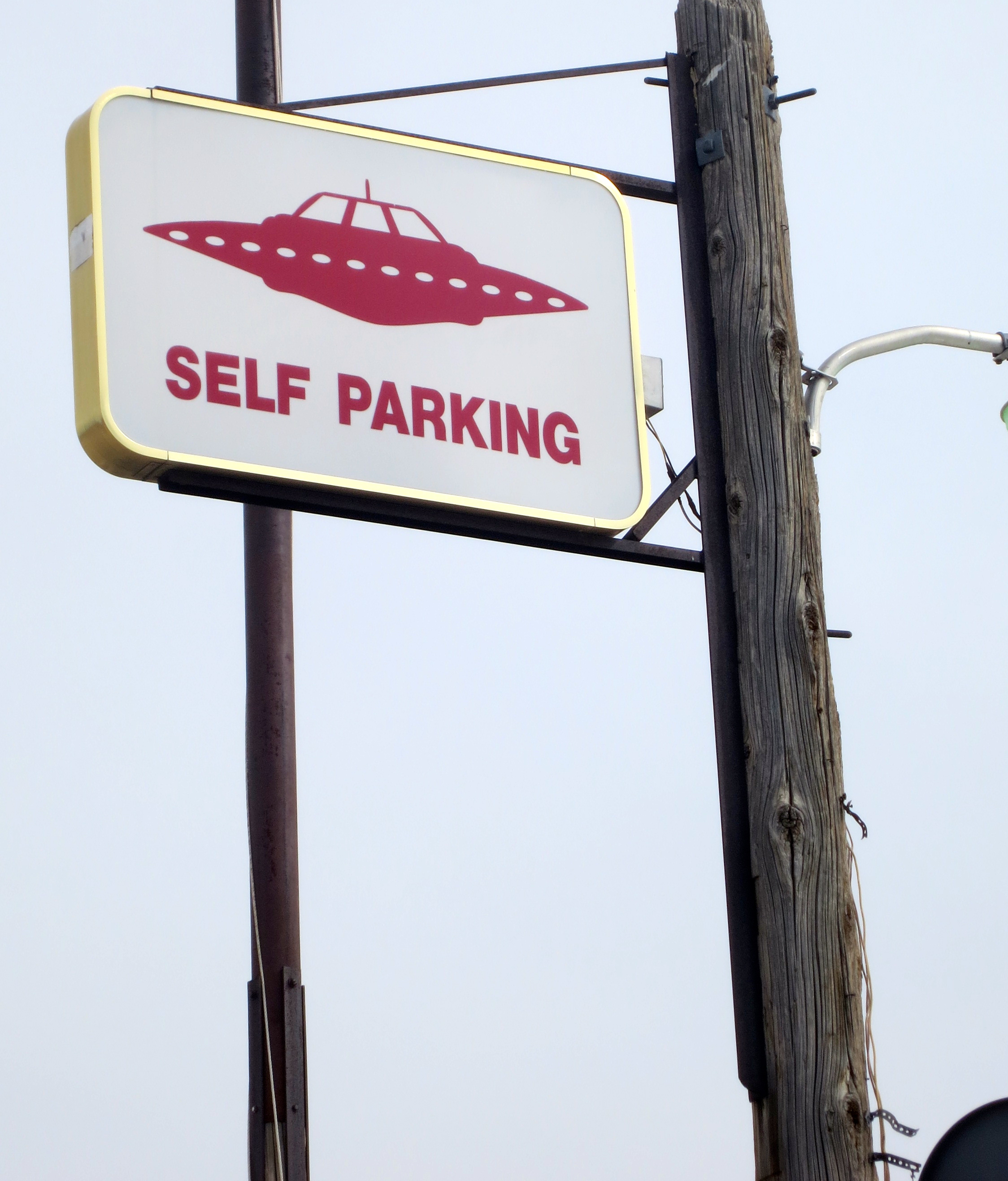 Self parking sign at the Little A'le'Inn in Rachel, Nevada.