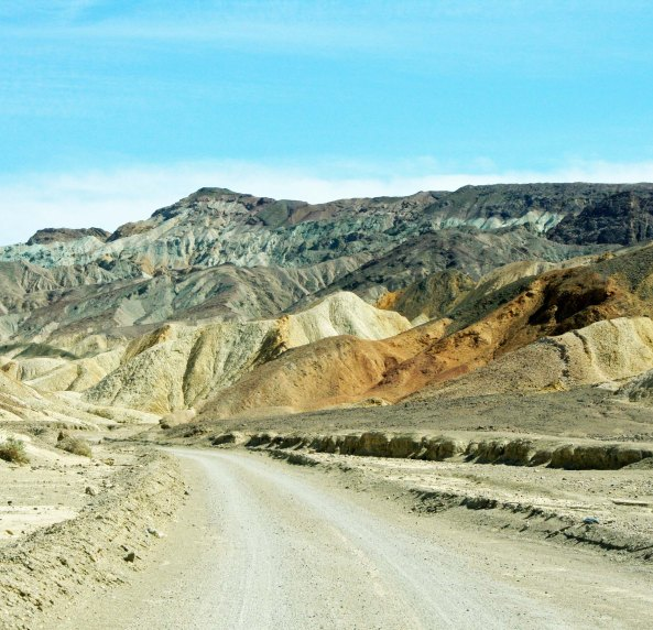 Road shot traveling through Twenty Mule Team Canyon in Death Valley National Park.