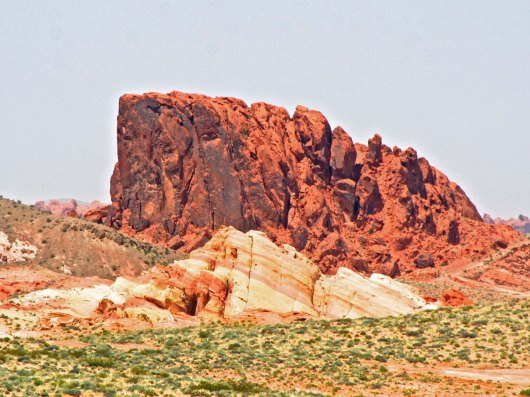 Peggy captured this impressive red mountain, which along with the red and tan sandstone rock on front provides another example of iron staining. The famous Red Wall of the Grand Canyon is also an example. (Photo by Peggy Mekemson.)