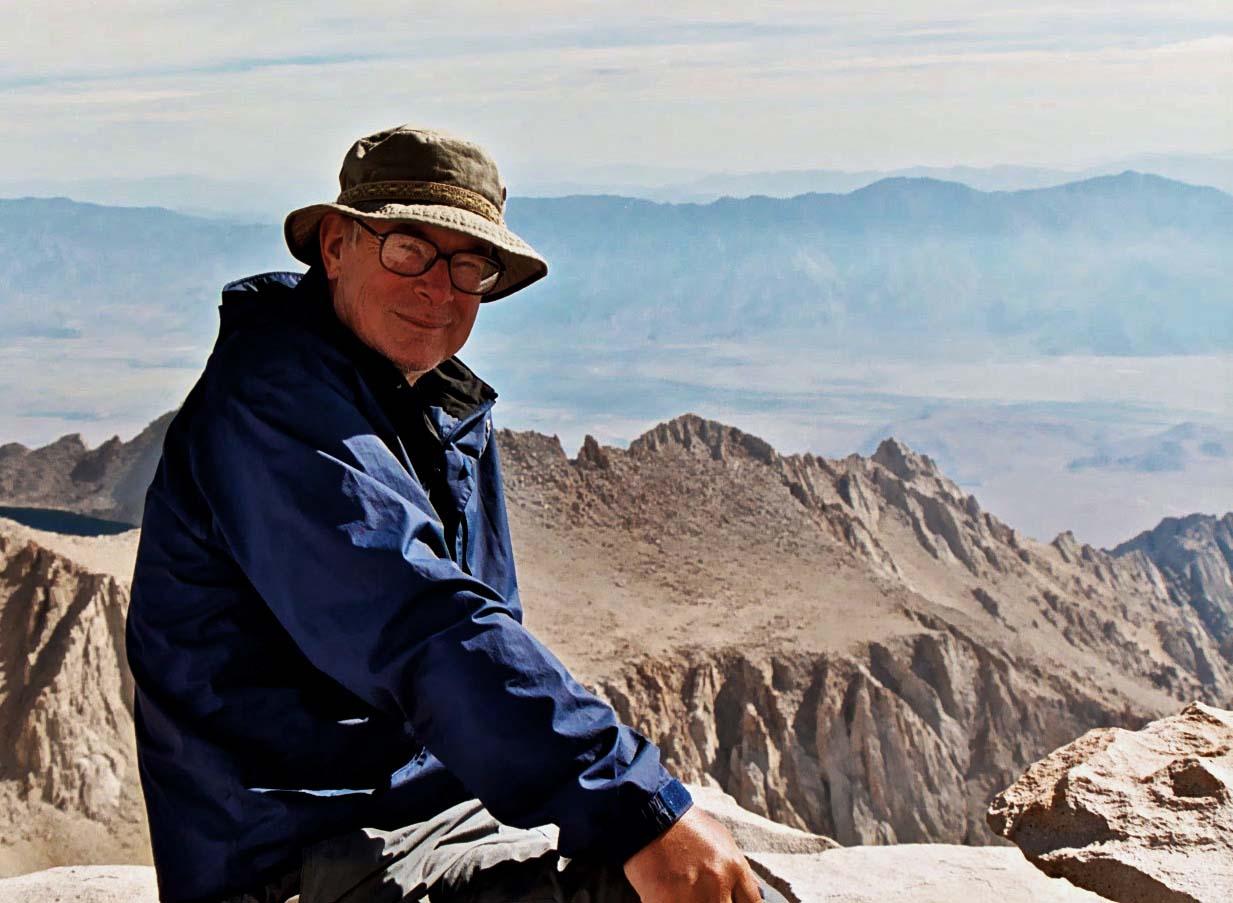 Curtis Mekemson sitting on top of Mt. Whitney.