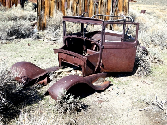 Old car remains at Bodie State Historical Park in California.