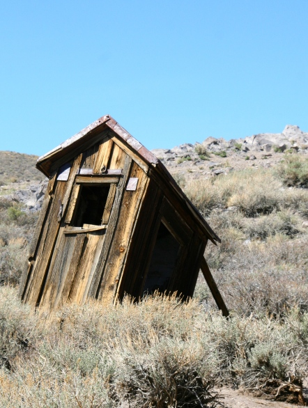 Propped up outhouse in the ghost town of Bodie, California.