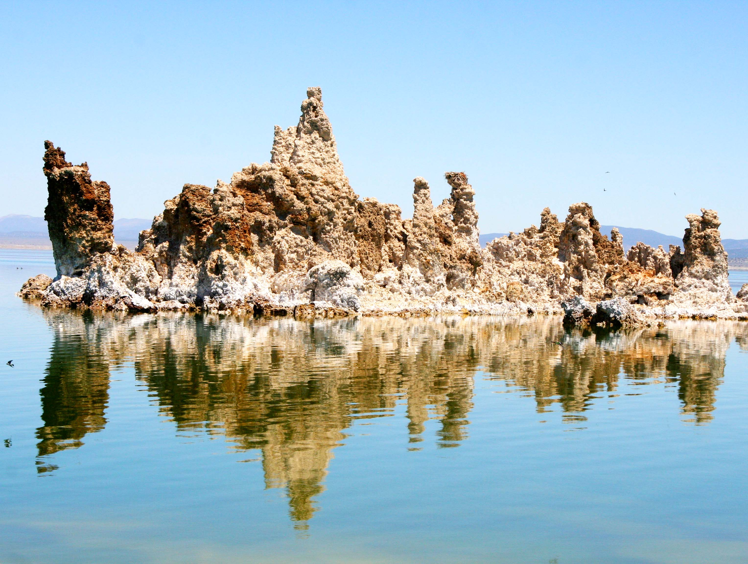 Reflections add extra character to this often photographed tufa island in Mono Lake. (Photo by Peggy Mekemson.)