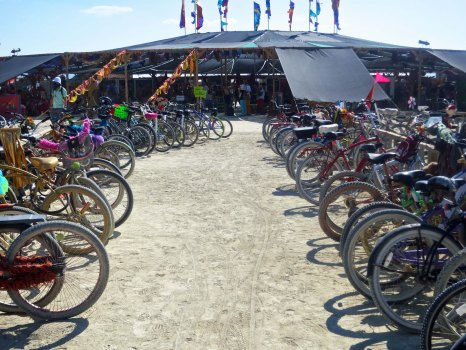 Bikes parked in front of the Center Camp Cafe at Burning Man 2014.