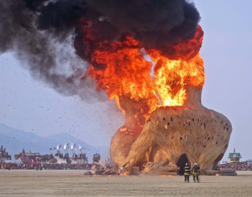 Embrace sculpture burns at Burning Man 2014. Photo by Curtis Mekemson.