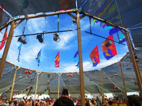 The middle of the Center Camp Cafe provides a large circular opening looking up at the sky and the flags.