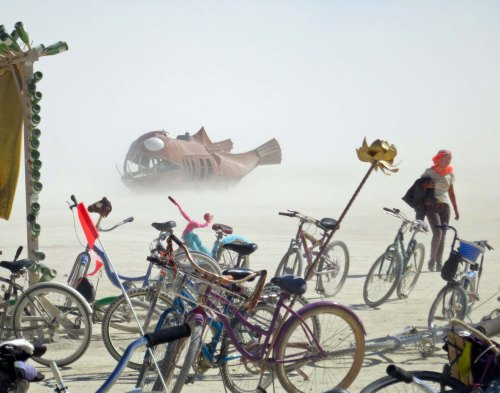 Fish mutant vehicle emerges out of a dust storm at Burning Man 2014. Photo by Curtis Mekemson.