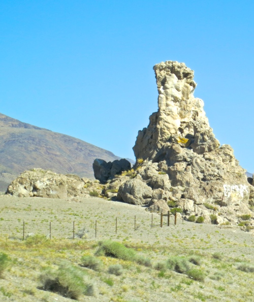Strange, hoodoo-like rocks greet Burners along the road into Burning Man. Somehow, they seem appropriate. (Photo by Peggy Mekemson.)