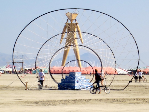 The Man surrounded by a souk/marketplace at Burning Man 2014.