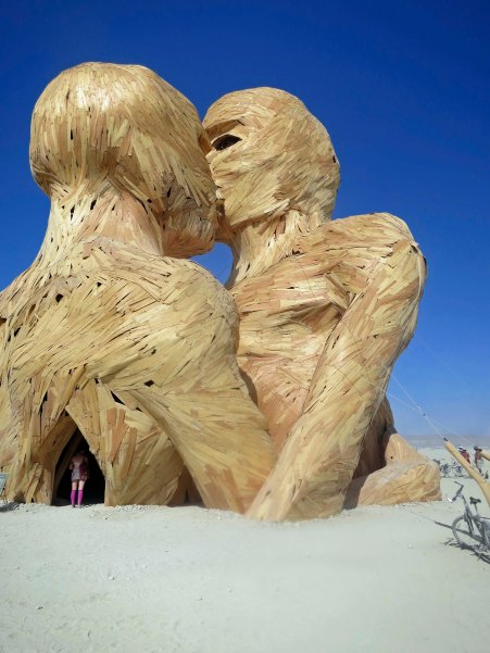 The Embrace sculpture at Burning Man 2014 provided access to go inside and climb up into the heads. Photo by Curtis Mekemson.