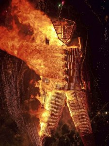 A close up of the Man burning at Burning Man 2014.