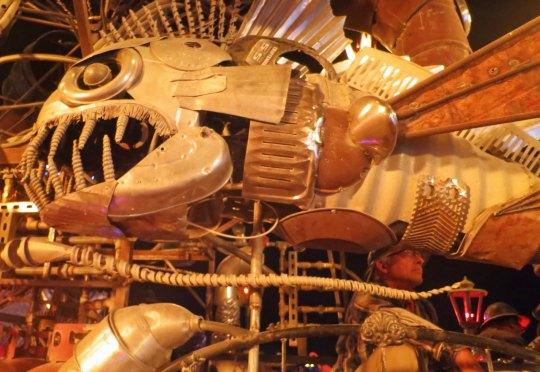 Fish sculpture found on El Pulp Mechanico shown at night, Burning Man 2014. Photo by Curtis Mekemson.