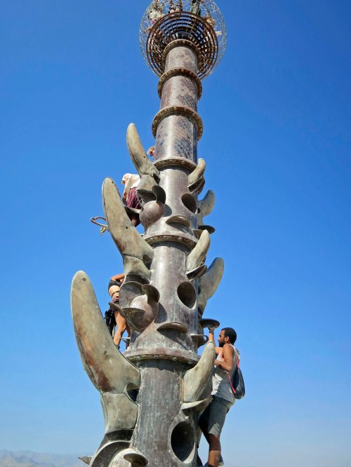 Climbing up a sculpture at Burning Man 2014. Photo by Curtis Mekemson.