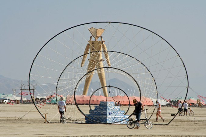 Geometric Sculpture and Man at Burning Man 2014. Photo by Curtis Mekemson.
