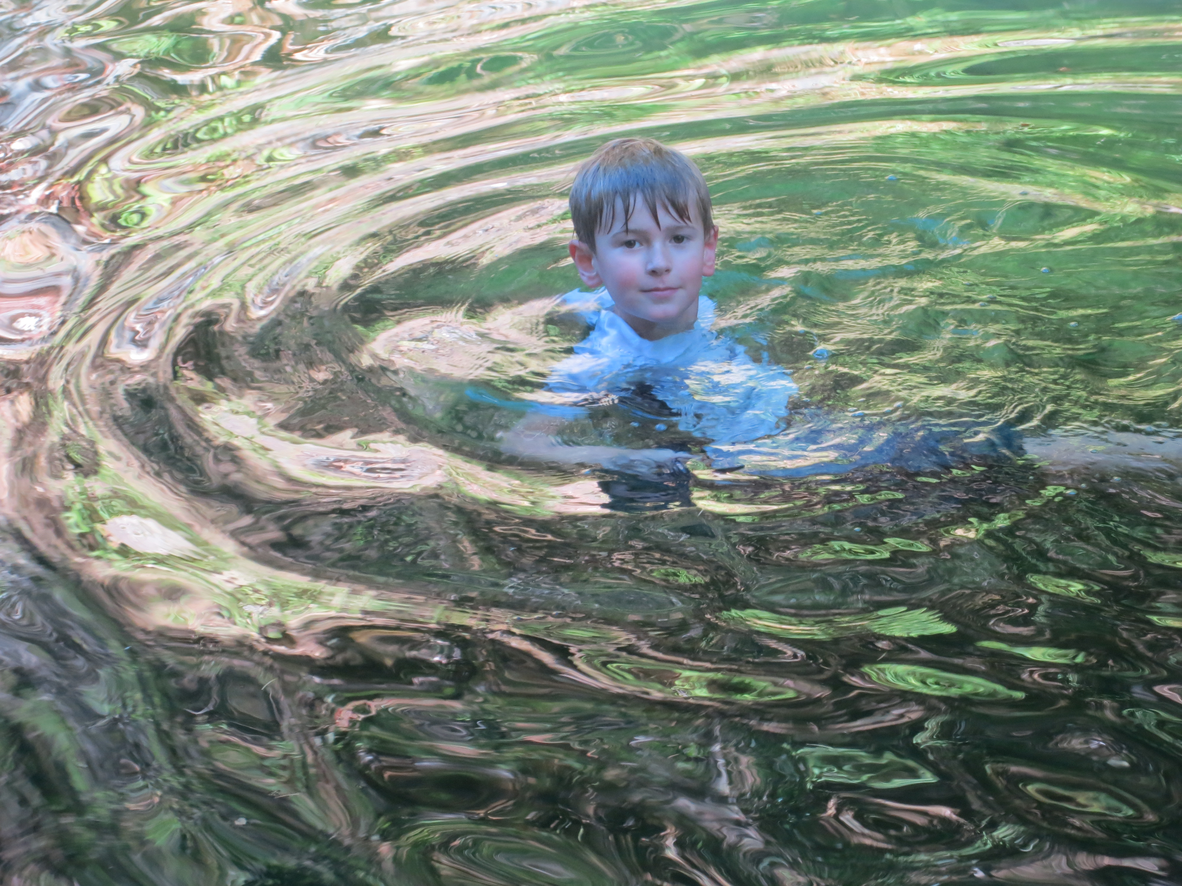 Our grandson Ethan enjoys a dip in the Applegate River this summer a few miles from our house .