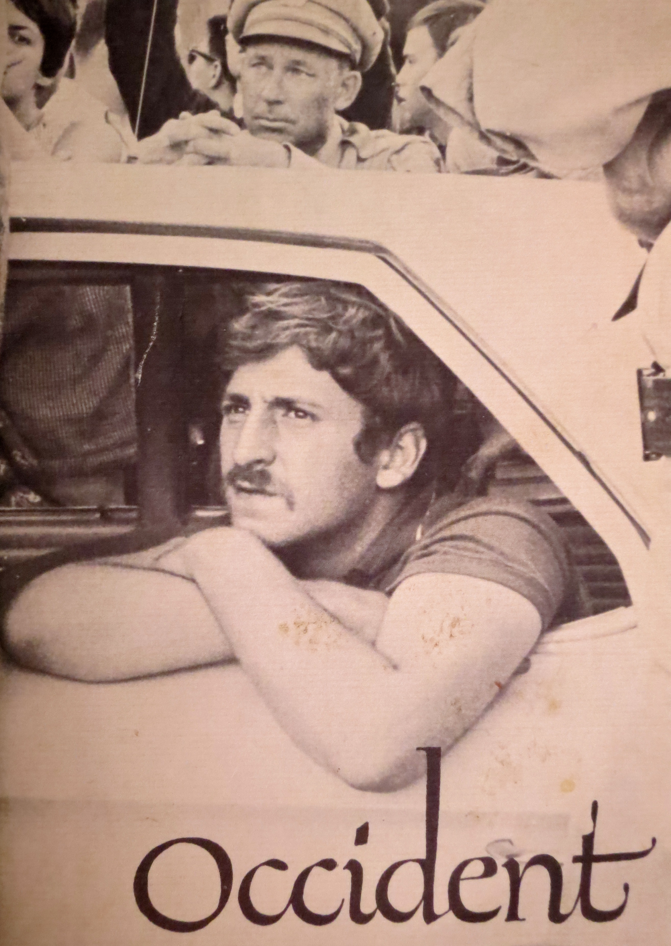 Jack Weinberg looks out the window of a police car on Sproul Plaza on the Berkeley Campus.