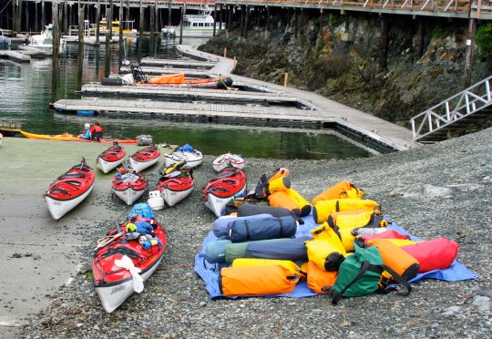 Sea kayaks wait for the next Sea Kayak Adventure tour group in Telegraph Cove.