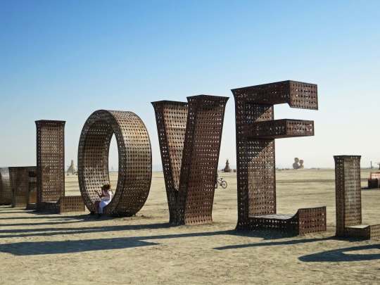 Love letters in the dust at Burning Man 2014. Photo by Curtis Mekemson.