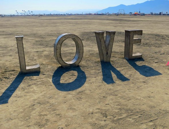 Shadowy love at Burning Man 2014. Photo by Curtis Mekemson.