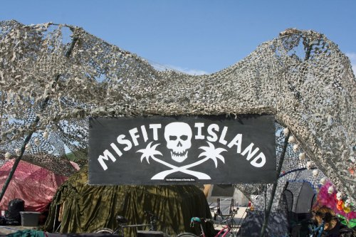 "In small print, under the skull and crossbones, this camp declared ""I am quite famous at Burning Man.""  (Photo by Peggy Mekemson.)"
