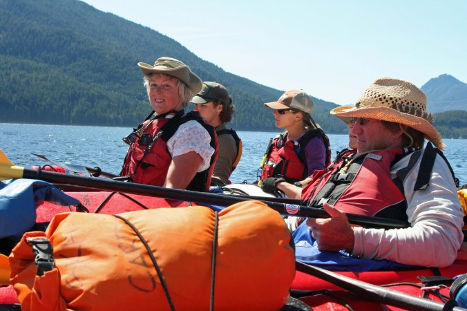 Kayakers with Kayak Adventure Tours raft up on Johnstone Strait in British Columbia when seeing a Killer Whale.