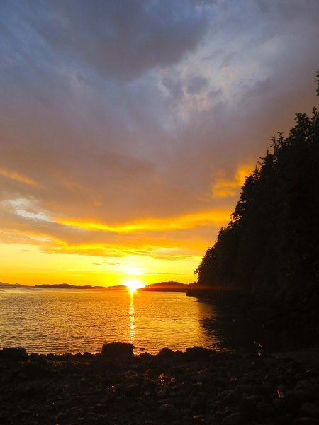 Sunset over Johnstone Striait off of Hanson Island. Photo by Curtis Mekemson.