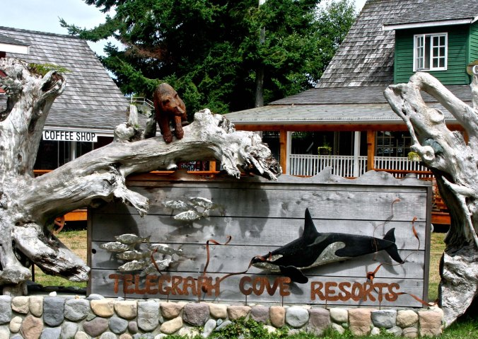 This sign, featuring an Orca, grizzly and salmon welcomes visitors to Telegraph Cove.