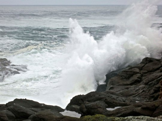 Powerful waves crash ashore on the Oregon coast. Photo by Curtis Mekemson.