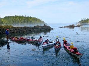 Sea Kayak Adventure kayaks roped together in small inlet on Hanson Island. Photo by Curtis Mekemson.