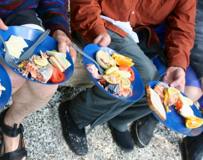 Sea Kayak Adventures cooks up a delicious lunch of freshly caught salmon at its camp on Compton Island, British Columbia.