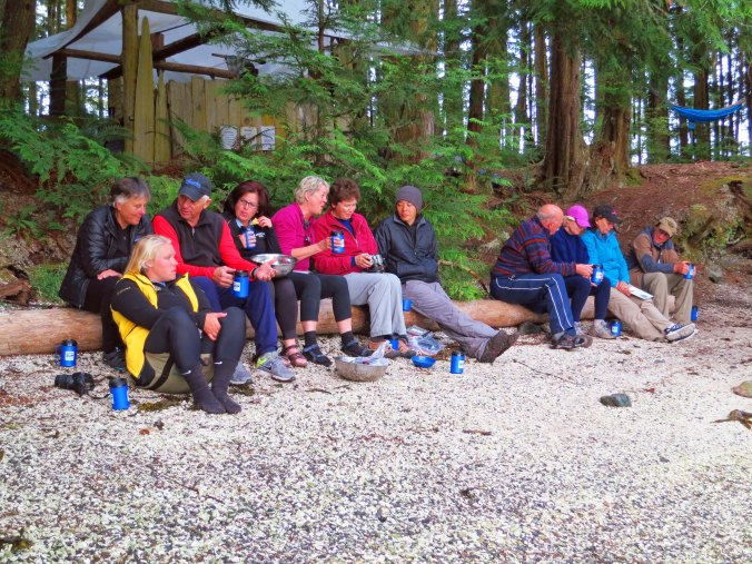 Sea Kayak Adventures group relaxes on beach at campsite on Compton Island, British Columbia.