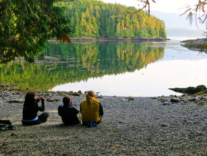 Members of our group enjoy a quiet moment at the end of the day, hoping for a whale to appear. Next blog: we kayak to Berry Island and hear a tale about Bigfoot.