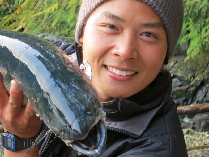 Quy was happy to pose with the salmon, until...