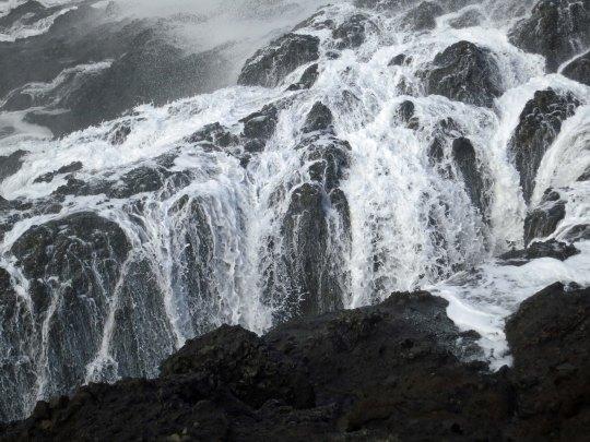 Wave retreats at Depoe Bay, Oregon. Photo by Curtis Mekemson.