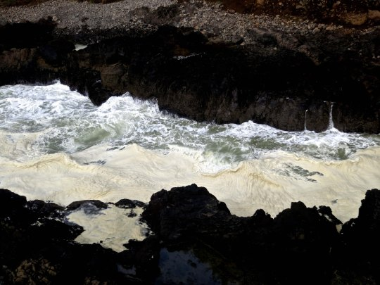 Devil's Churn on Central oregon coast showing whip cream like texture of waves. Photo by Curtis Mekemson.