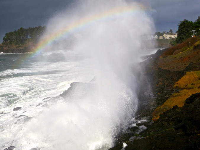 October: Rainbow caught in waves on Oregon Coast.