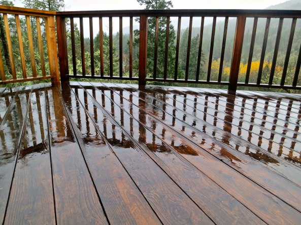 Our deck reflects the rain.